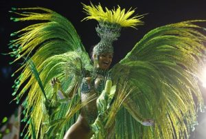 A reveller of the Imperatriz samba school performs during the carnival parade at the Sambadrome in Rio de Janeiro, February 9, 2016. REUTERS/Pilar Olivares
